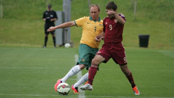 Pararoos captain David Barber vies for the ball with Russia's Eduard Ramonov.